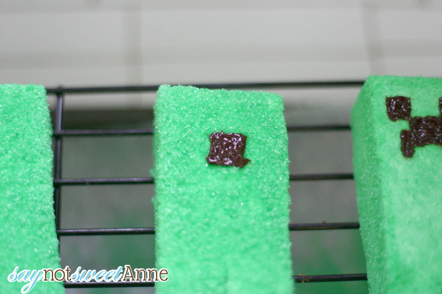 Unbelievable Minecraft Creeper Peeps! Marshmallow candies covered in green sugar are easy to make, especially with this step by step how to! These will be great for any Easter basket, or Minecraft birthday party, or even Halloween! | saynotsweetanne.com