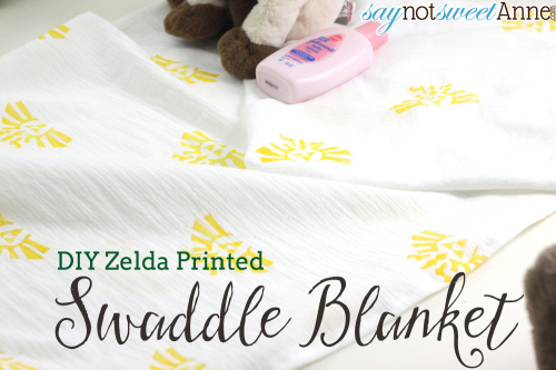 Easy DIY Swaddle Blanket - I printed mine with the Zelda Royal Crest!, but you could stamp your own or buy patterned fabric! | syanotsweetanne.com