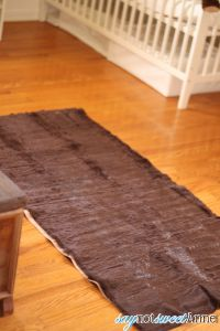 Easy DIY Faux Animal Skin Rug. Create an awesome accent rug with just a couple of fabric yards and some ingenuity!  | Saynotsweetanne.com