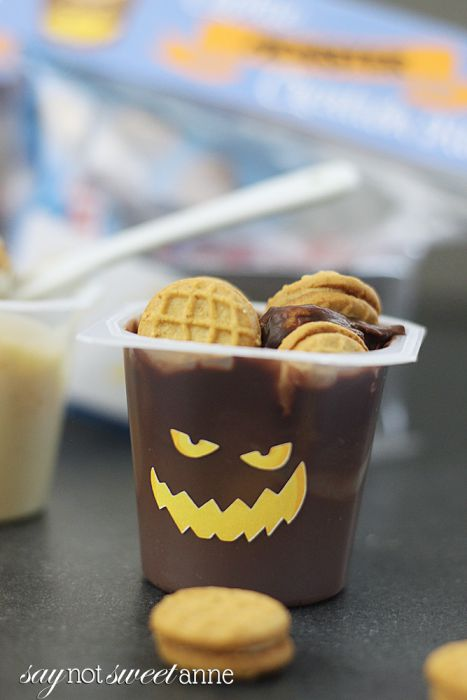 """DIY Cookie """"Monster"""" Kit uses Snack Pack pudding cups, single serve cookies and some awesome stickers to make a hands on Halloween Treat!   saynotsweetanne.com"""