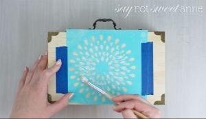 Easy DIY Watercolor Stenciled Box. Great way to dress up a boring craft store box, or add a wash of color to any wooden project! | Saynotsweetanne.com