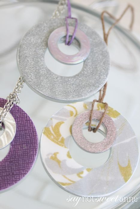 A more refined technique for a simple DIY Washer Necklace. These lovely charms are made from every day materials, but look upscale and can be totally unique!   saynotsweetanne.com