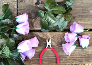 Beautiful and Easy Easter Egg Wreath made from low cost materials and perfect for spring! Fill with candy and give as a unique non-easter basket!   saynotsweetanne.com