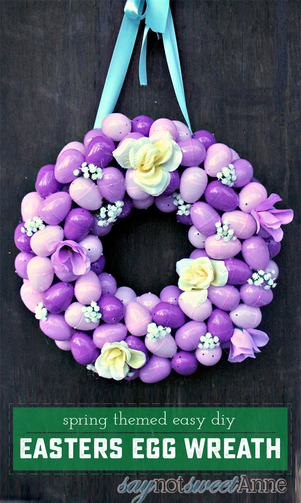 Beautiful and Easy Easter Egg Wreath made from low cost materials and perfect for spring! Fill with candy and give as a unique non-easter basket! | saynotsweetanne.com