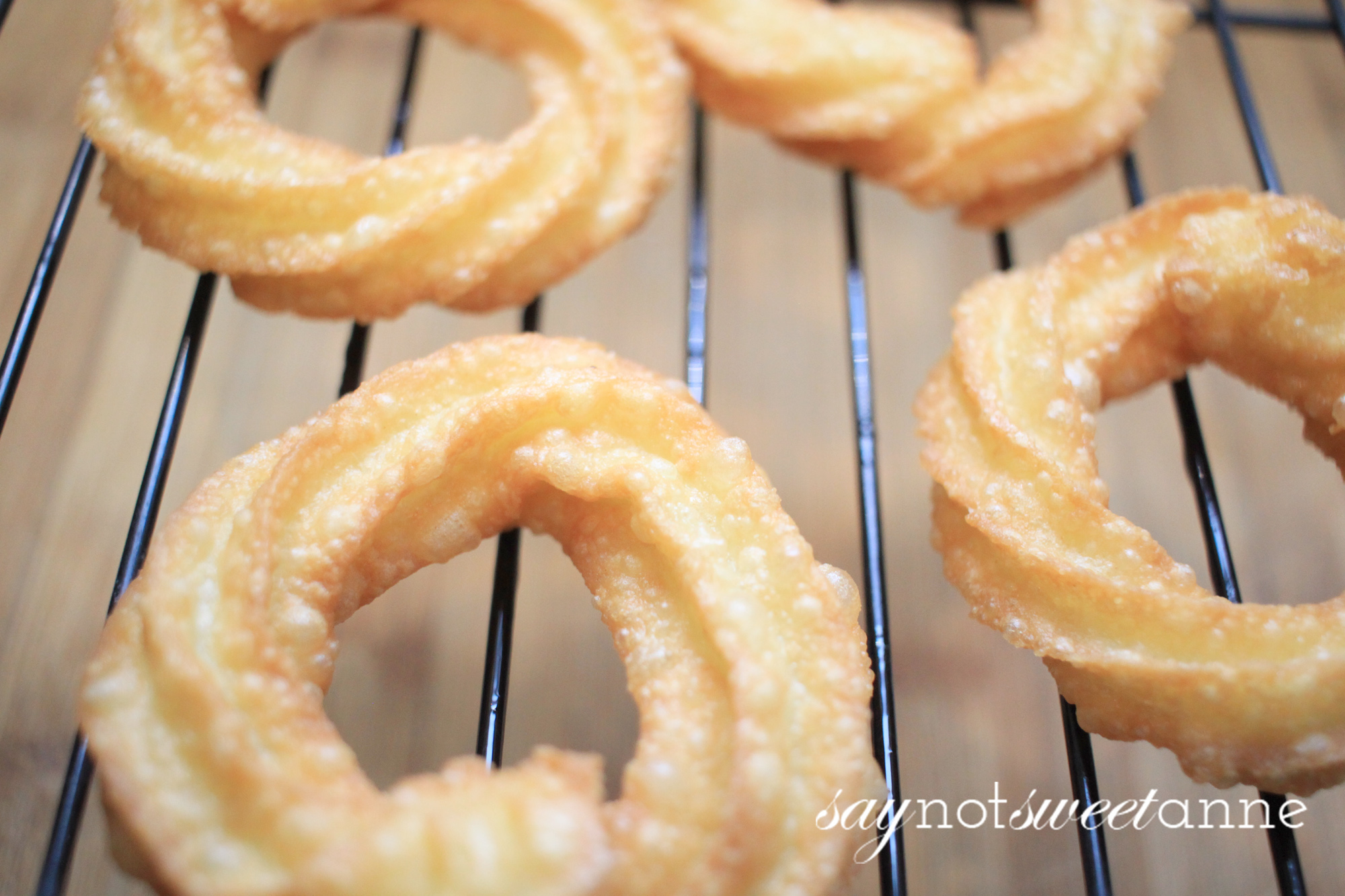 Simplified and Easy French Crullers! Perfect for a weekend treat, or to serve to guests. A time honored and somewhat tricky recipe demystified! |Saynotsweetanne.com