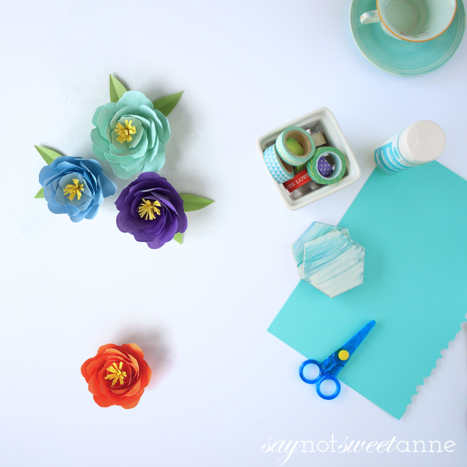 Make beautiful Peony flowers using just paper. Perfect for decor, kids crafts, baby and wedding showers - the works! | saynotsweetanne.com